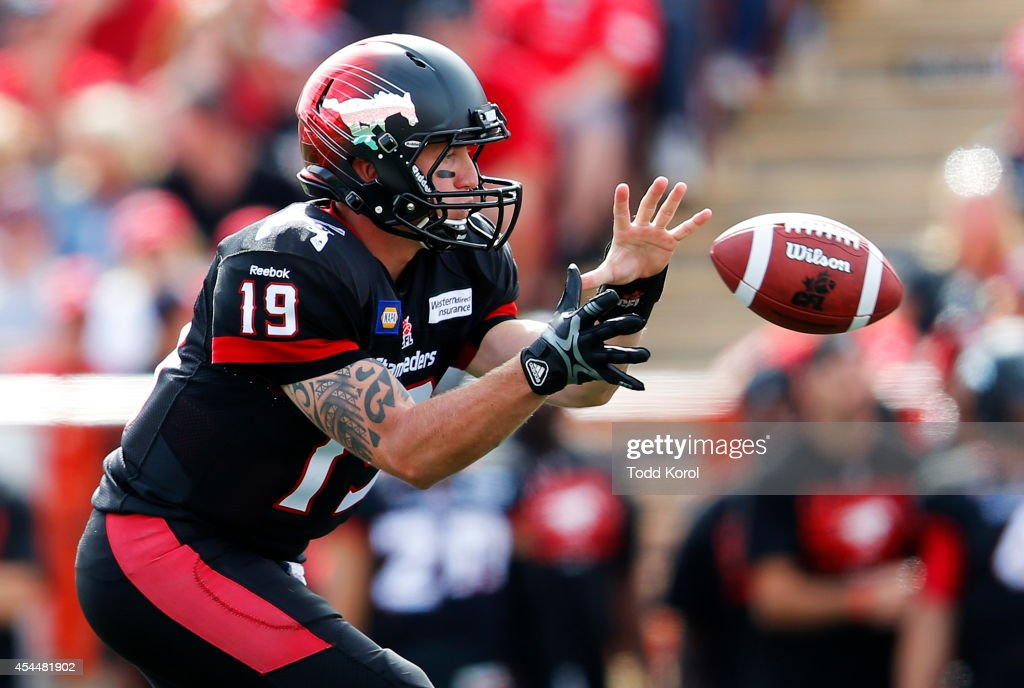 Quarterback Bo Levi Mitchell #19 of the Calgary Stampeders catches a snap in the first half of their CFL football game against the Edmonton Eskimos September 1, 2014 at McMahon Stadium in Calgary, Alberta, Canada.