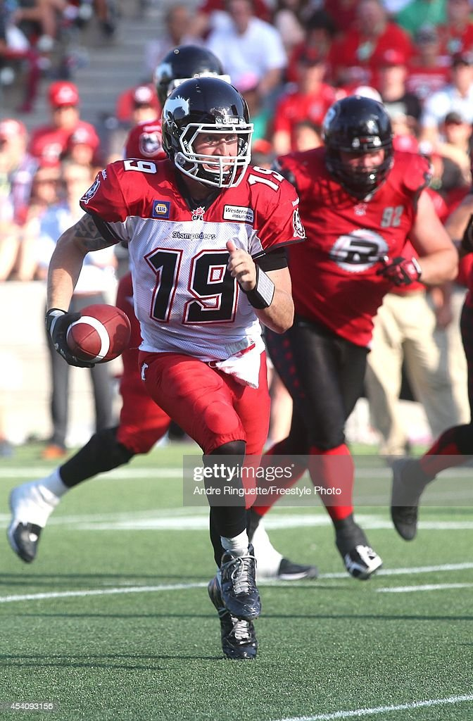 Quarterback Bo Levi Mitchell #19 of the Calgary Stampeders runs for a first down during third quarter action against the Ottawa Redblacks in a CFL game at TD Place Stadium on August 24, 2014 in Ottawa, Ontario, Canada.