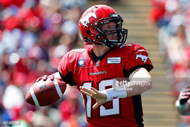 Quarterback Bo Levi Mitchell of the Calgary Stampeders throws a pass against the Montreal Alouettes in the first half of their CFL football game at...