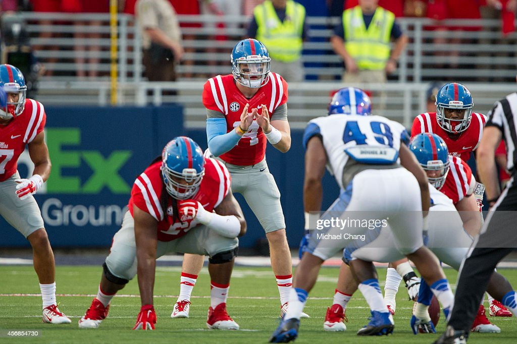 Quarterback Bo Wallace of the Mississippi Rebels prepares to hike the ball during their game against the Memphis Tigers on September 27 2014 at...