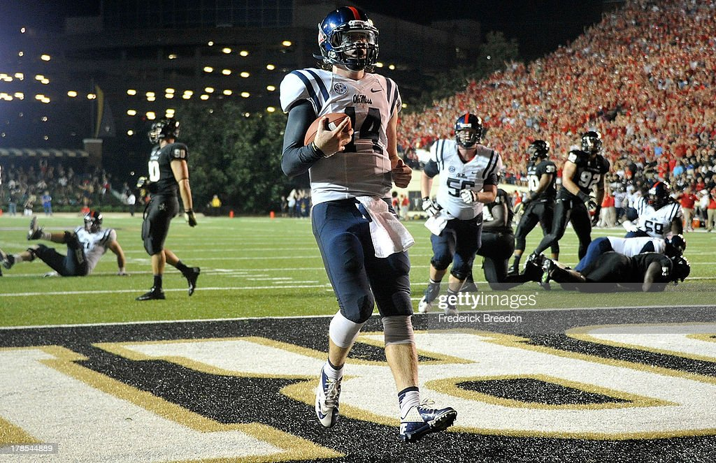 Quarterback Bo Wallace #14 of the Ole Miss Rebels scores a touchdown against the Vanderbilt Commodores at Vanderbilt Stadium on August 29, 2013 in Nashville, Tennessee.
