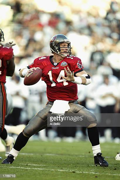 Quarterback Brad Johnson of the Tampa Bay Buccaneers looks for a receiver during Super Bowl XXXVII against the Oakland Raiders at Qualcomm Stadium on...
