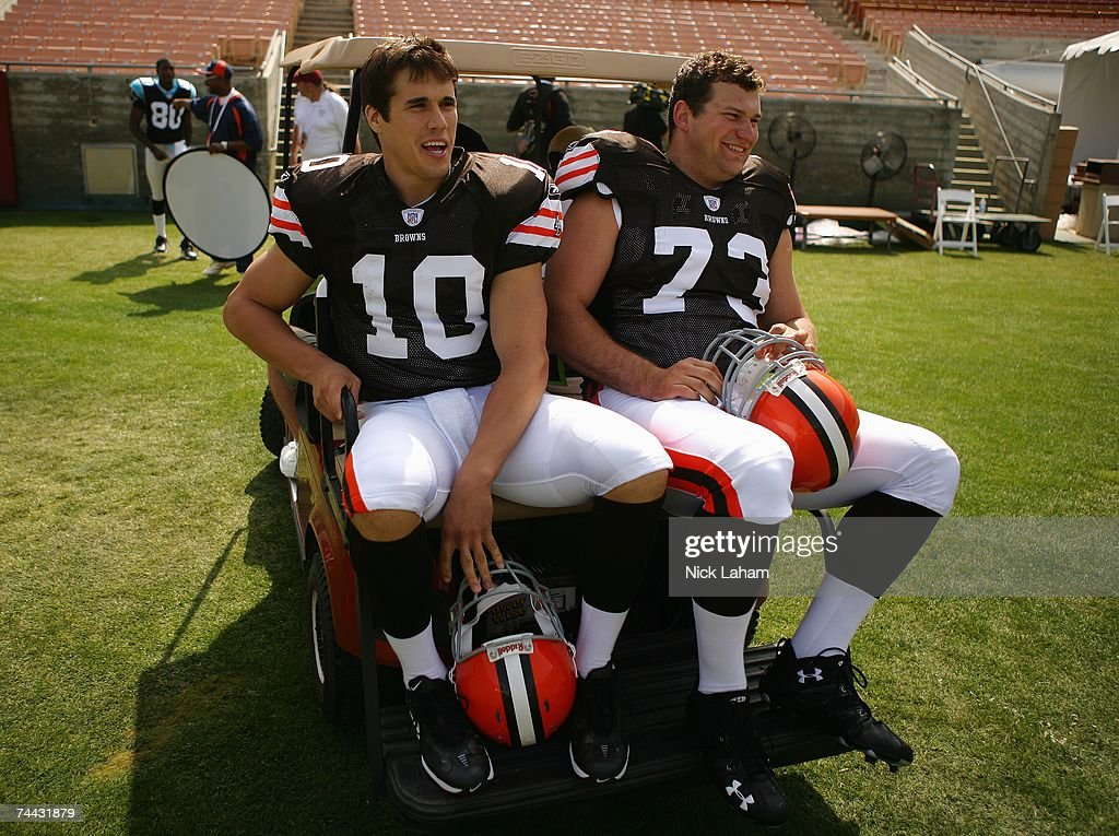 Quarterback Brady Quinn of the Cleveland Browns rides on the back of a golf cart with team mate offensive tackle Joe Thomas at the 2007 NFL Players...