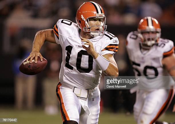 Quarterback Brady Quinn of the Cleveland Browns scrambles to throw a touchdown pass during the fourth quarter of a preseason game against the Detroit...