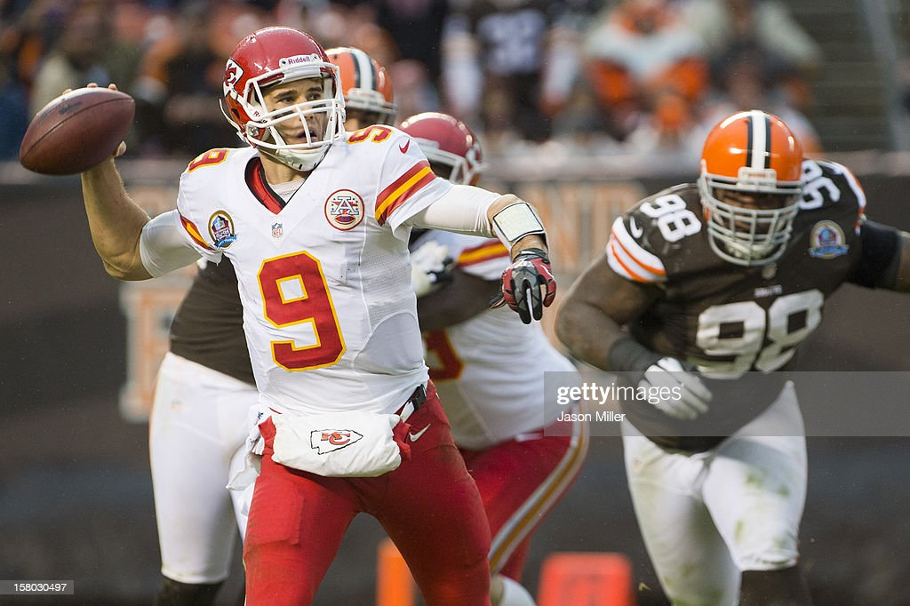 Quarterback Brady Quinn #9 of the Kansas City Chiefs looks for a pass under pressure from defensive tackle Phillip Taylor #98 of the Cleveland Browns during the second half at Cleveland Browns Stadium on December 9, 2012 in Cleveland, Ohio. The Browns defeated the Chiefs 30-7.