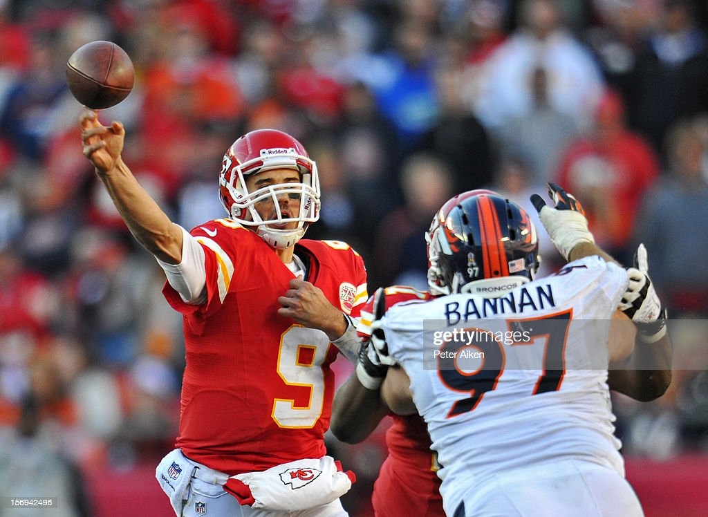 Quarterback Brady Quinn #9 of the Kansas City Chiefs throws a pass under pressure from nose tackle Justin Bannan #97 of the Denver Broncos during the second half on November 25, 2012 at Arrowhead Stadium in Kansas City, Missouri. Denver defeated Kansas City 17-9.