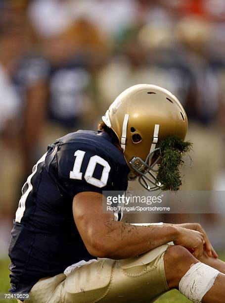 Quarterback Brady Quinn of the Notre Dame Fighting Irish gets a face full of grass in his helmet against the Michigan Wolverines on September 16 2006...