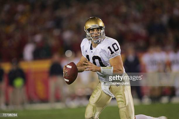 Quarterback Brady Quinn of the Notre Dame Fighting Irish looks for a receiver against the USC Trojans at the Los Angeles Memorial Coliseum on...