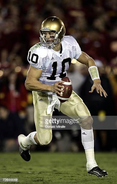 Quarterback Brady Quinn of the Notre Dame Fighting Irish scrambles against the USC Trojans in the first half of their game on November 25 2006 at the...