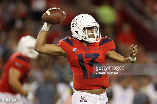 Quarterback Brandon Dawkins of the Arizona Wildcats looks to pass during the second half of the college football game against the Northern Arizona...