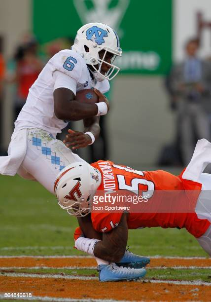 UNC quarterback Brandon Harris is sacked in the backfield by Virginia Tech linebacker Andrew Motuapuaka during a college football game between the...