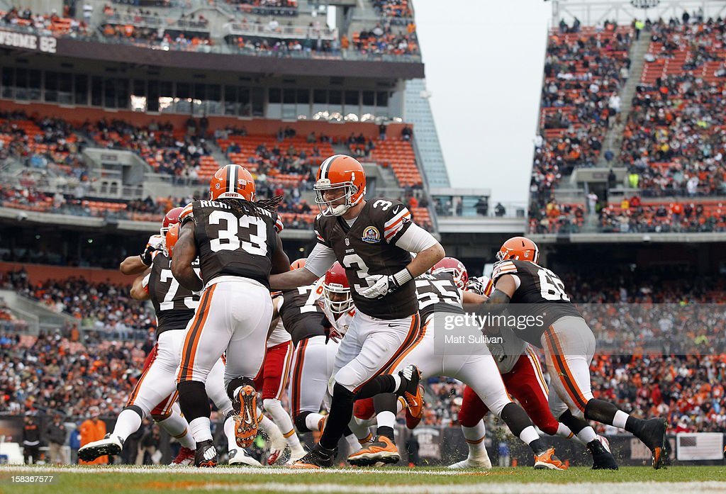 Quarterback Brandon Weeden #3 of the Cleveland Browns hands off the ball to running back Trent Richardson #33 against the Kansas City Chiefs at Cleveland Browns Stadium on December 9, 2012 in Cleveland, Ohio.
