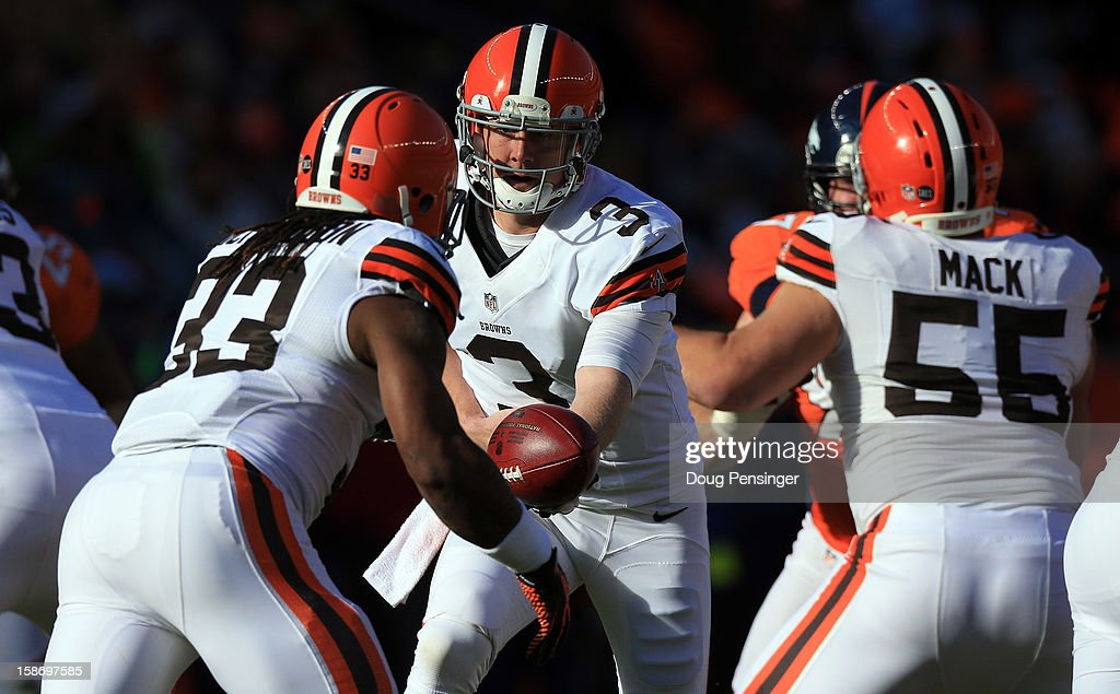 Quarterback Brandon Weeden #3 of the Cleveland Browns hands the ball off to running back Trent Richardson #33 of the Cleveland Browns against the Denver Broncos at Sports Authority Field at Mile High on December 23, 2012 in Denver, Colorado. The Broncos defeated the Browns 34-12.