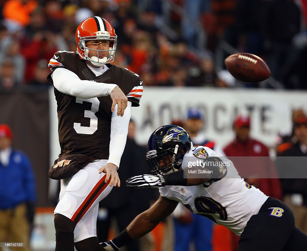 Quarterback Brandon Weeden #3 of the Cleveland Browns throws as he is pressured by linebacker Arthur Brown #59 of the Baltimore Ravens at FirstEnergy Stadium on November 3, 2013 in Cleveland, Ohio.