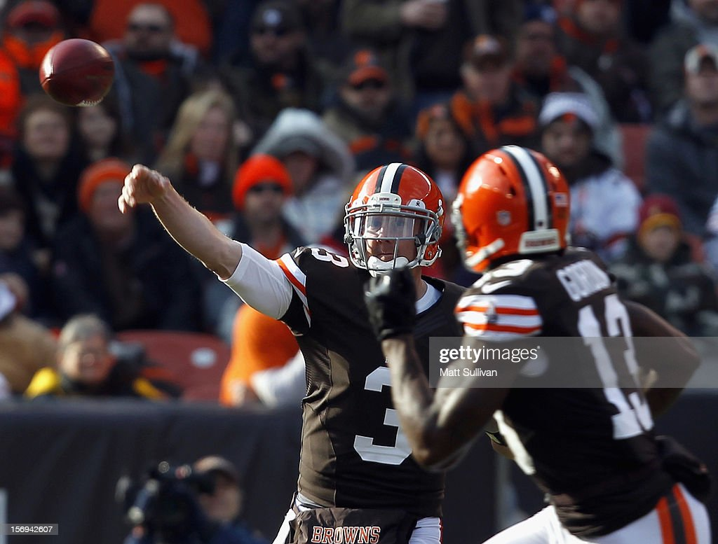 Quarterback <a gi-track='captionPersonalityLinkClicked' href=/galleries/search?phrase=Brandon+Weeden&family=editorial&specificpeople=7125737 ng-click='$event.stopPropagation()'>Brandon Weeden</a> #3 of the Cleveland Browns throws to wide receiver Josh Gordon #13 against the Pittsburgh Steelers at Cleveland Browns Stadium on November 25, 2012 in Cleveland, Ohio.