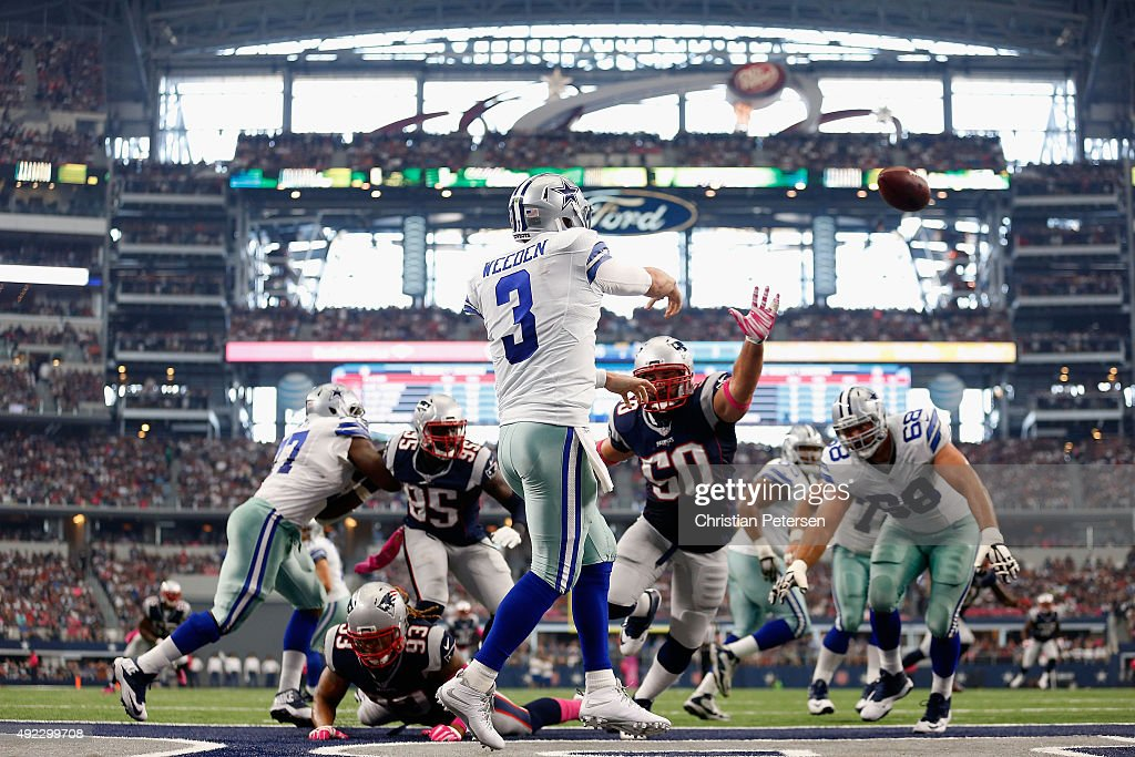 Quarterback <a gi-track='captionPersonalityLinkClicked' href=/galleries/search?phrase=Brandon+Weeden&family=editorial&specificpeople=7125737 ng-click='$event.stopPropagation()'>Brandon Weeden</a> #3 of the Dallas Cowboys passes from the end zone as defensive end <a gi-track='captionPersonalityLinkClicked' href=/galleries/search?phrase=Rob+Ninkovich&family=editorial&specificpeople=741417 ng-click='$event.stopPropagation()'>Rob Ninkovich</a> #50 of the New England Patriots applies pressure during the first half of the NFL game at AT&T Stadium on October 11, 2015 in Arlington, Texas.