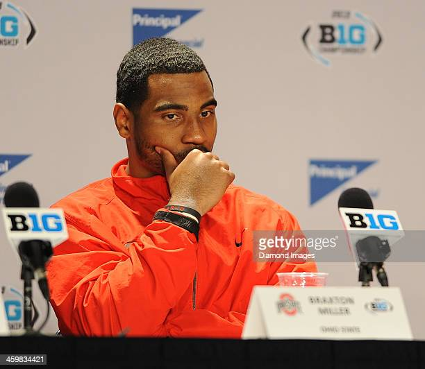 Quarterback Braxton MIller of the Ohio State Buckeyes answers questions from the media during the post game press conference after a game against the...