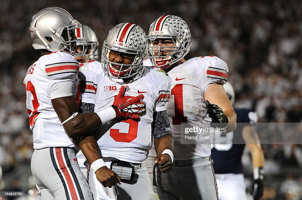 Quarterback <a gi-track='captionPersonalityLinkClicked' href=/galleries/search?phrase=Braxton+Miller&family=editorial&specificpeople=7122480 ng-click='$event.stopPropagation()'>Braxton Miller</a> #5 of the Ohio State Buckeyes celebrates after scoring a touchdown against the Penn State Nittany Lions in the third quarter at Beaver Stadium on October 27, 2012 in State College, Pennsylvania.