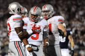Quarterback Braxton Miller of the Ohio State Buckeyes celebrates after scoring a touchdown against the Penn State Nittany Lions in the third quarter...