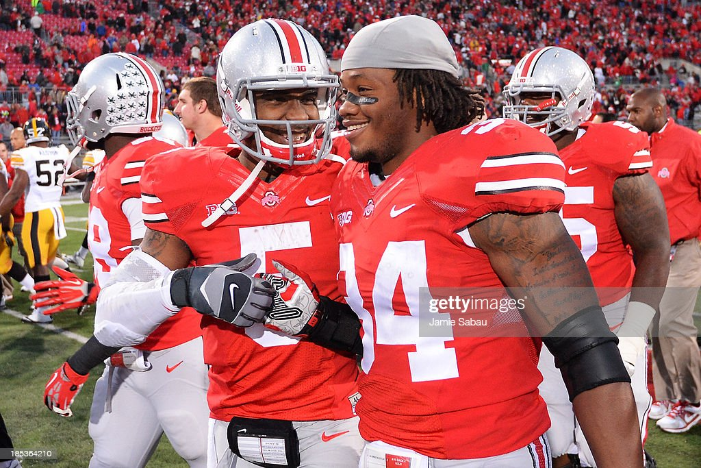 Quarterback <a gi-track='captionPersonalityLinkClicked' href=/galleries/search?phrase=Braxton+Miller&family=editorial&specificpeople=7122480 ng-click='$event.stopPropagation()'>Braxton Miller</a> #5 of the Ohio State Buckeyes celebrates with Jamal Marcus #34 of the Ohio State Buckeyes after the Buckeyes defeated the Iowa Hawkeyes 34-24 at Ohio Stadium on October 19, 2013 in Columbus, Ohio.