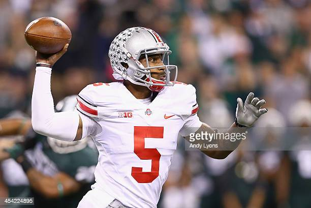 Quarterback Braxton Miller of the Ohio State Buckeyes delivers a pass during the Big Ten Conference Championship game against the Michigan State...
