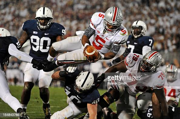 Quarterback Braxton Miller of the Ohio State Buckeyes dives into the end zone for touchdown against the Penn State Nittany Lions in the third quarter...