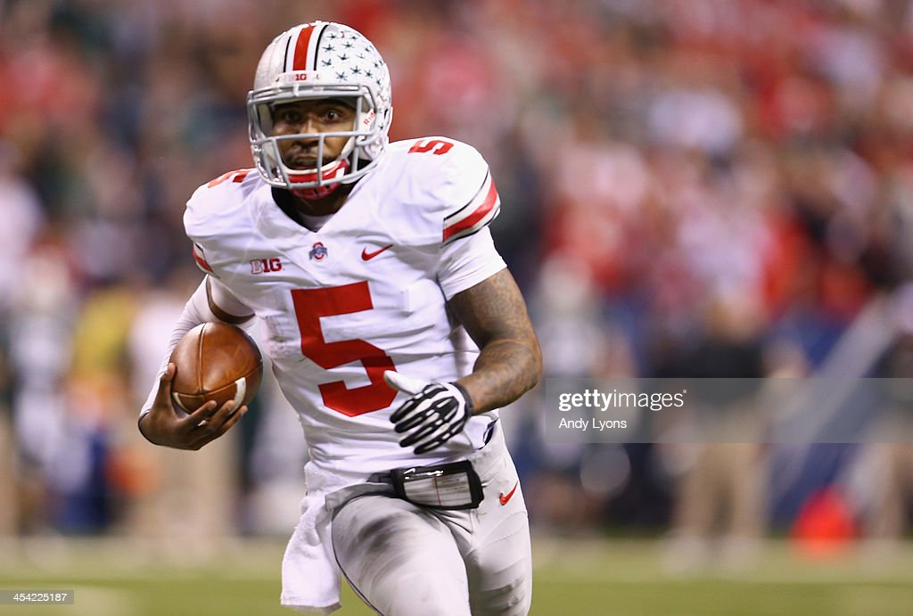 Quarterback <a gi-track='captionPersonalityLinkClicked' href=/galleries/search?phrase=Braxton+Miller&family=editorial&specificpeople=7122480 ng-click='$event.stopPropagation()'>Braxton Miller</a> #5 of the Ohio State Buckeyes looks to run during the Big Ten Conference Championship game against the Michigan State Spartans at Lucas Oil Stadium on December 7, 2013 in Indianapolis, Indiana.