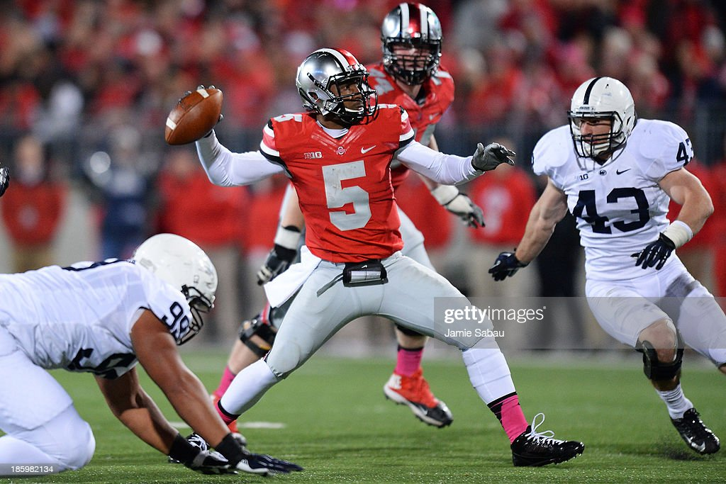 Quarterback <a gi-track='captionPersonalityLinkClicked' href=/galleries/search?phrase=Braxton+Miller&family=editorial&specificpeople=7122480 ng-click='$event.stopPropagation()'>Braxton Miller</a> #5 of the Ohio State Buckeyes passes in the first half as Mike Hull #43 of the Penn State Nittany Lions closes in at Ohio Stadium on October 26, 2013 in Columbus, Ohio. Ohio State defeated Penn State 63-14.
