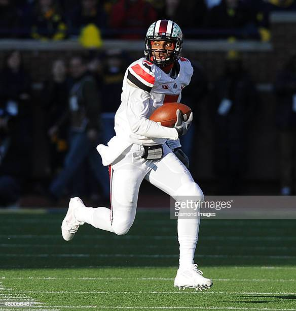 Quarterback Braxton Miller of the Ohio State Buckeyes runs the football during a game against the Michigan Wolverines at Michigan Stadium in Ann...