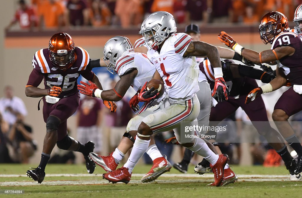 Quarterback <a gi-track='captionPersonalityLinkClicked' href=/galleries/search?phrase=Braxton+Miller&family=editorial&specificpeople=7122480 ng-click='$event.stopPropagation()'>Braxton Miller</a> #1 of the Ohio State Buckeyes rushes for a long touchdown against the Virginia Tech Hokies in the second half at Lane Stadium on September 7, 2015 in Blacksburg, Virginia. Ohio State defeated Virginia Tech 42-24.