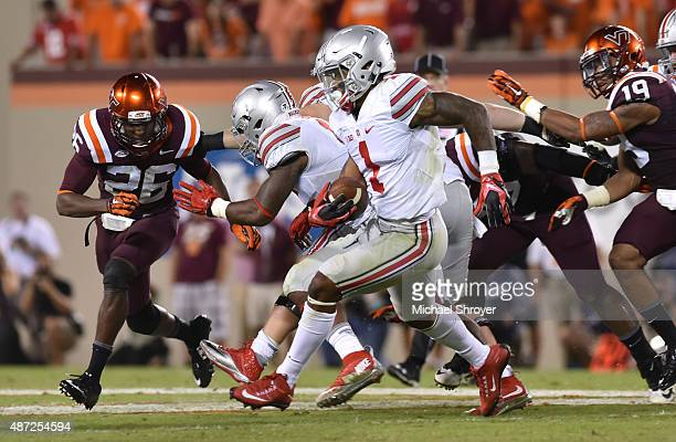 Quarterback Braxton Miller of the Ohio State Buckeyes rushes for a long touchdown against the Virginia Tech Hokies in the second half at Lane Stadium...