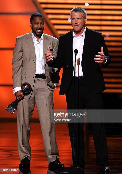 NFL quarterback Brett Favre and wide receiver Greg Lewis speak onstage after winning the ESPY for Best Play during the 2010 ESPY Awards at Nokia...