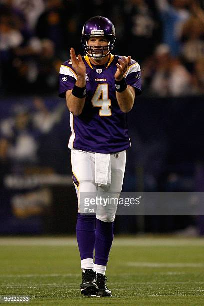 Quarterback Brett Favre of the Minnesota Vikings celebrates a first down while playing against the Dallas Cowboys during the NFC Divisional Playoff...