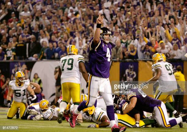 Quarterback Brett Favre of the Minnesota Vikings celebrates after a touchdown during the game against the Green Bay Packers on October 5 2009 at...