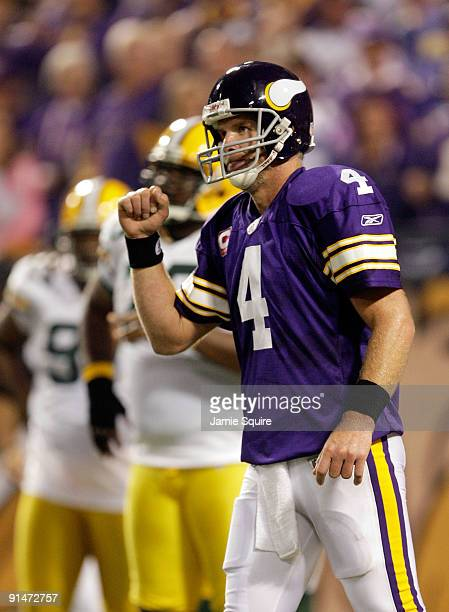Quarterback Brett Favre of the Minnesota Vikings pumps his fist after a penalty against the Green Bay Packers during the game on October 5 2009 at...