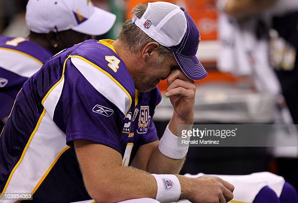 Quarterback Brett Favre of the Minnesota Vikings sits on the bench dejected late in the fourth quarter against the New Orleans Saints at Louisiana...
