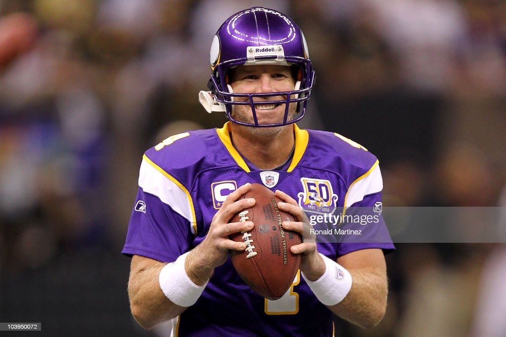 Quarterback <a gi-track='captionPersonalityLinkClicked' href=/galleries/search?phrase=Brett+Favre&family=editorial&specificpeople=167102 ng-click='$event.stopPropagation()'>Brett Favre</a> #4 of the Minnesota Vikings smiles as he warms up against the New Orleans Saints at Louisiana Superdome on September 9, 2010 in New Orleans, Louisiana.