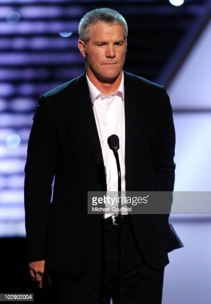 NFL quarterback Brett Favre presents the Arthur Ashe Courage Award onstage during the 2010 ESPY Awards at Nokia Theatre LA Live on July 14 2010 in...