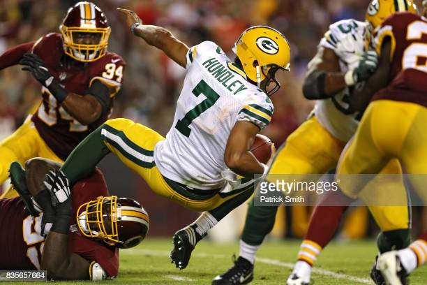 Quarterback Brett Hundley of the Green Bay Packers is sacked by defensive tackle Phillip Taylor of the Washington Redskins in the first half during a...
