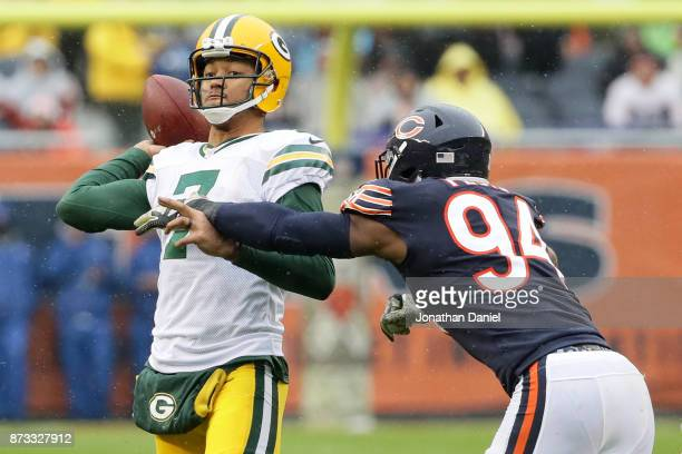 Quarterback Brett Hundley of the Green Bay Packers passes the football against Leonard Floyd of the Chicago Bears in the third quarter at Soldier...