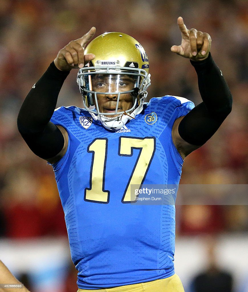 Quarterback <a gi-track='captionPersonalityLinkClicked' href=/galleries/search?phrase=Brett+Hundley&family=editorial&specificpeople=8674236 ng-click='$event.stopPropagation()'>Brett Hundley</a> #17 of the UCLA Bruins celebrates a Myles Jack three yard touchdown run in the first quarter against the USC Trojans at Los Angeles Coliseum on November 30, 2013 in Los Angeles, California.
