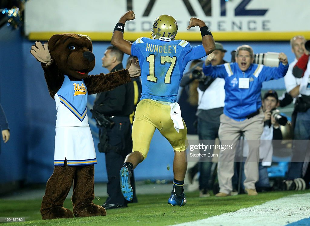 Quarterback Brett Hundley #17 of the UCLA Bruins celebrates in the end zone after scoring on a 15 yard touchdown run in the third quarter against the USC Trojans at the Rose Bowl on November 22, 2014 in Pasadena, California.