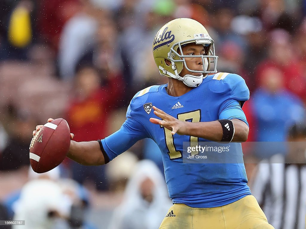 Quarterback <a gi-track='captionPersonalityLinkClicked' href=/galleries/search?phrase=Brett+Hundley&family=editorial&specificpeople=8674236 ng-click='$event.stopPropagation()'>Brett Hundley</a> #17 of the UCLA Bruins drops back to pass against the USC Trojans in the first half at the Rose Bowl on November 17, 2012 in Pasadena, California. UCLA defeated USC