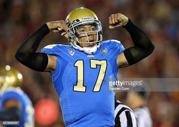 Quarterback Brett Hundley of the UCLA Bruins flexes as he celebrates a Myles Jack three yard touchdown run in the first quarter against the USC...