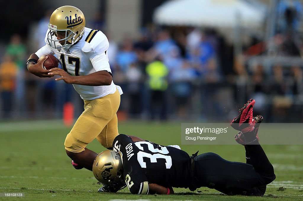 Quarterback <a gi-track='captionPersonalityLinkClicked' href=/galleries/search?phrase=Brett+Hundley&family=editorial&specificpeople=8674236 ng-click='$event.stopPropagation()'>Brett Hundley</a> #17 of the UCLA Bruins is tackled by linebacker Paul Vigo #32 of the Colorado Buffaloes at Folsom Field on September 29, 2012 in Boulder, Colorado. UCLA defeated Colorado 42-14.