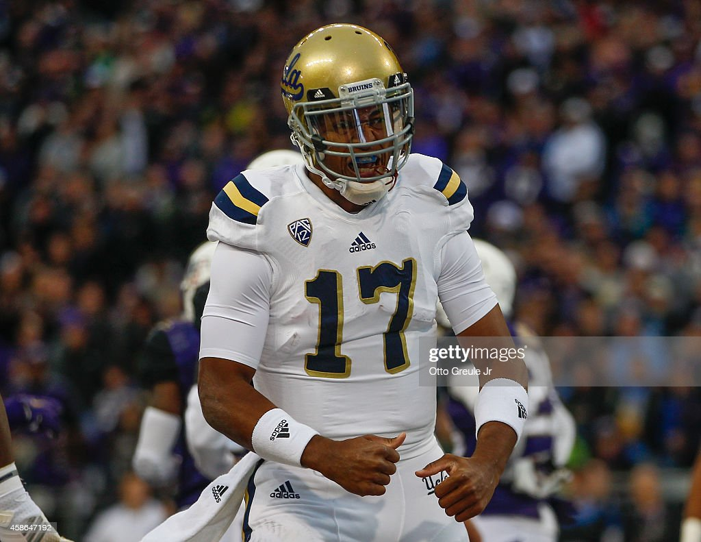 Quarterback <a gi-track='captionPersonalityLinkClicked' href=/galleries/search?phrase=Brett+Hundley&family=editorial&specificpeople=8674236 ng-click='$event.stopPropagation()'>Brett Hundley</a> #17 of the UCLA Bruins reacts after scoring a touchdown in the first quarter against the Washington Huskies on November 8, 2014 at Husky Stadium in Seattle, Washington.
