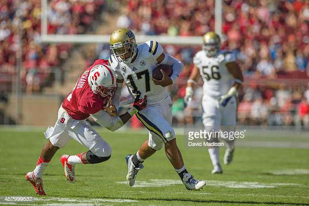 Quarterback Brett Hundley of the UCLA Bruins runs during an NCAA football game against the Stanford Cardinal on October 19 2013 at Stanford Stadium...