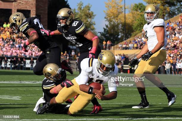 Quarterback Brett Hundley of the UCLA Bruins rushes into the endzone for a touchdown against the Colorado Buffaloes to take a 70 lead in the first...