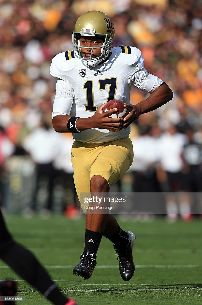 Quarterback <a gi-track='captionPersonalityLinkClicked' href=/galleries/search?phrase=Brett+Hundley&family=editorial&specificpeople=8674236 ng-click='$event.stopPropagation()'>Brett Hundley</a> #17 of the UCLA Bruins rushes into the endzone for a touchdown against the Colorado Buffaloes to take a 7-0 lead in the first quarter at Folsom Field on September 29, 2012 in Boulder, Colorado.
