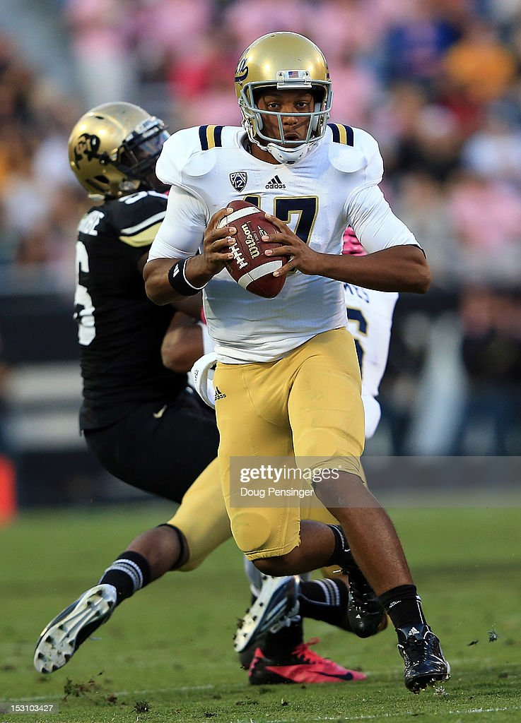 Quarterback <a gi-track='captionPersonalityLinkClicked' href=/galleries/search?phrase=Brett+Hundley&family=editorial&specificpeople=8674236 ng-click='$event.stopPropagation()'>Brett Hundley</a> #17 of the UCLA Bruins scrambles against the Colorado Buffaloes at Folsom Field on September 29, 2012 in Boulder, Colorado. UCLA defeated Colorado 42-14.